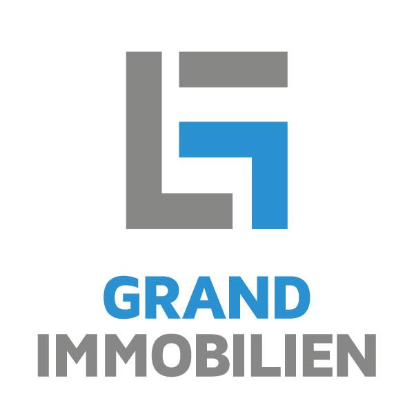 grand immobilien logo